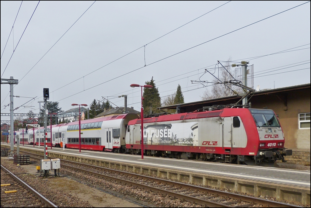 . 4010 is entering with bilevel cars into the station of Wasserbililg on April 8th, 2013.
