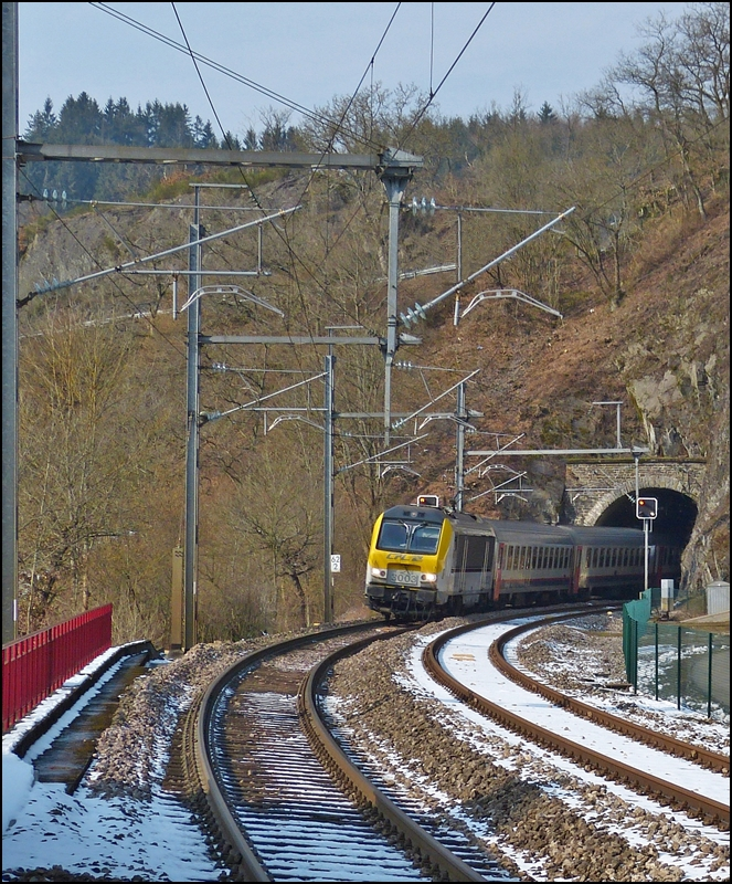 . The IR 117 Liers - Luxembourg City is leaving the tunnel Kircherg, just before entering into the station of Kautenbach on March 25th, 2013.