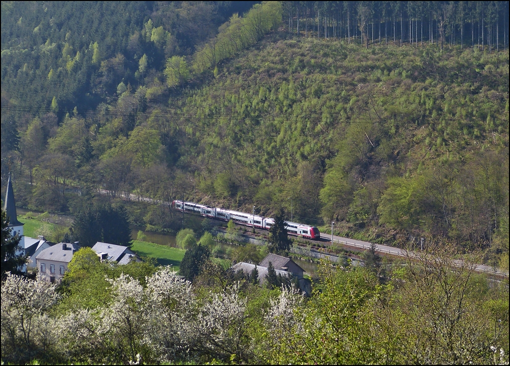 . The RB 3208 Luxembourg City - Wiltz is running along the river Wiltz in Kautenbach on May 5th, 2013.