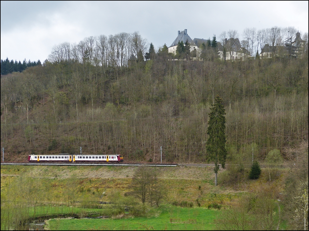 . The RE 3362 Wiltz - Kautenbach pictured while running along the castle of Wiltz on April 20th, 2012.