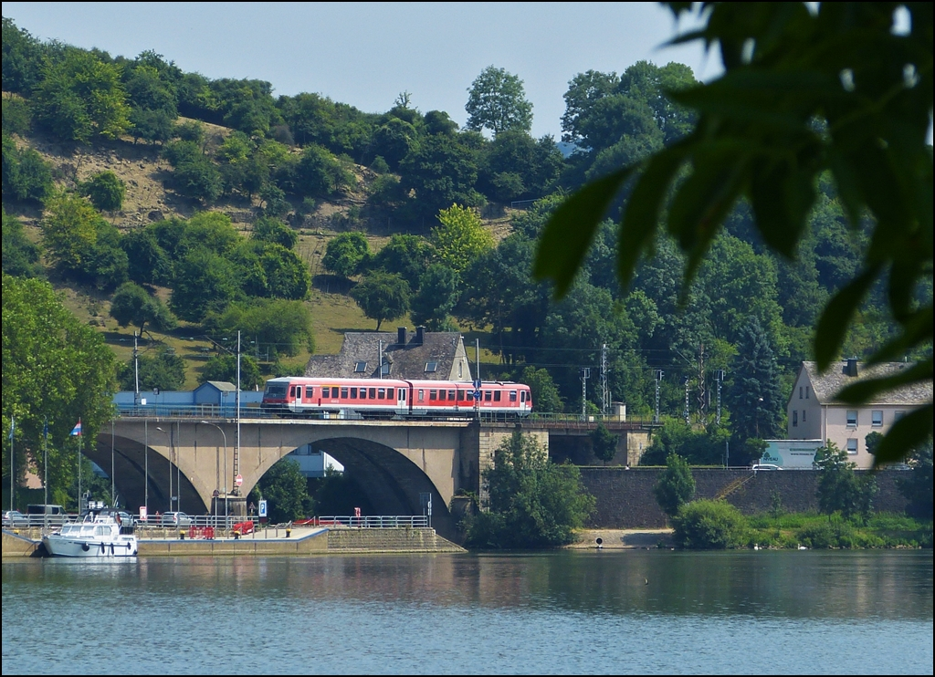 . The RE 5211 Luxembourg City - Trier is running on the Sûre bridge in Wasserbillig on July 16th, 2013.