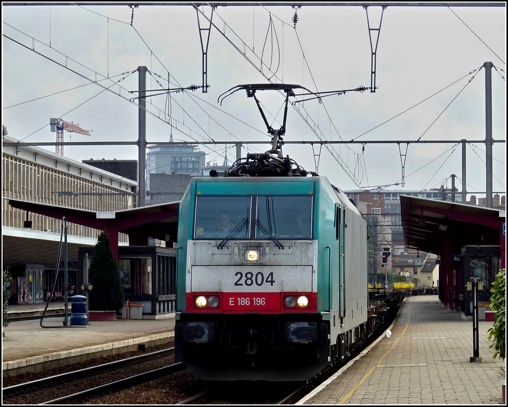 . The TRAXX HLE 2804 is hauling a freight train through the station of Hasselt on March 11th, 2011.
