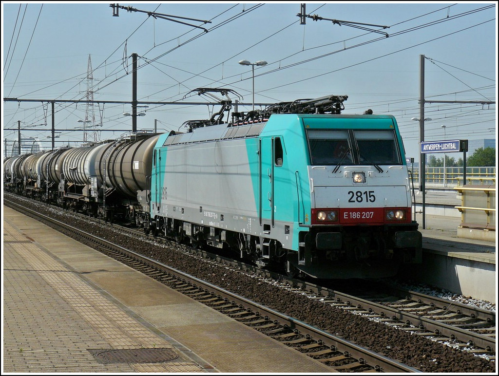 . The TRAXX HLE 2815 is hauling a freight train throug the station Antwerpen-Luchtbal on June 23rd, 2010.