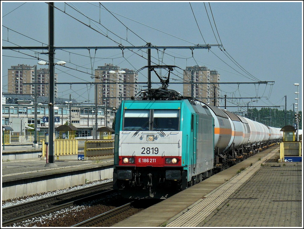 . The TRAXX HLE 2819 is hauling a goods train through the station Antwerpen-Luchtbal on June 23rd, 2010.
