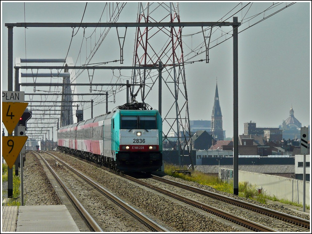 . The TRAXX HLE 2836 is hauling the IC Brussels - Amsterdam through the station Antwerpen-Luchtbal on June 23rd, 2010.