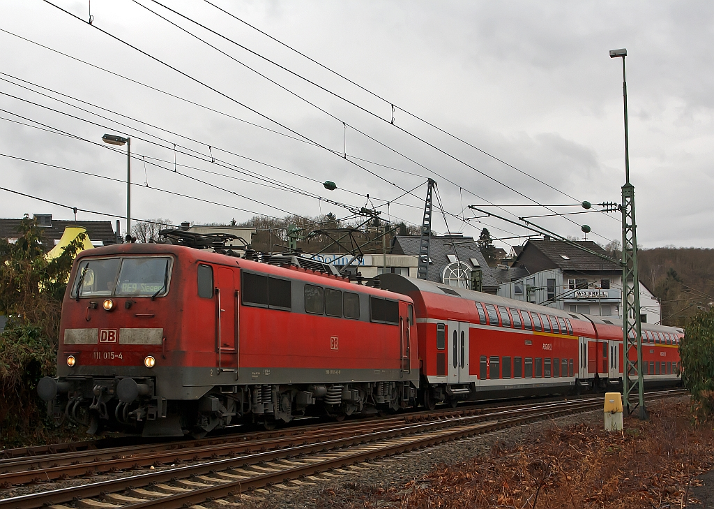 111 015-4 with RE 9 (Rhein-Sieg-Express) Aachen - Cologne - Siegen, has leave here the station Betzdorf/Sieg and continue towards Siegen (04.12.2011).