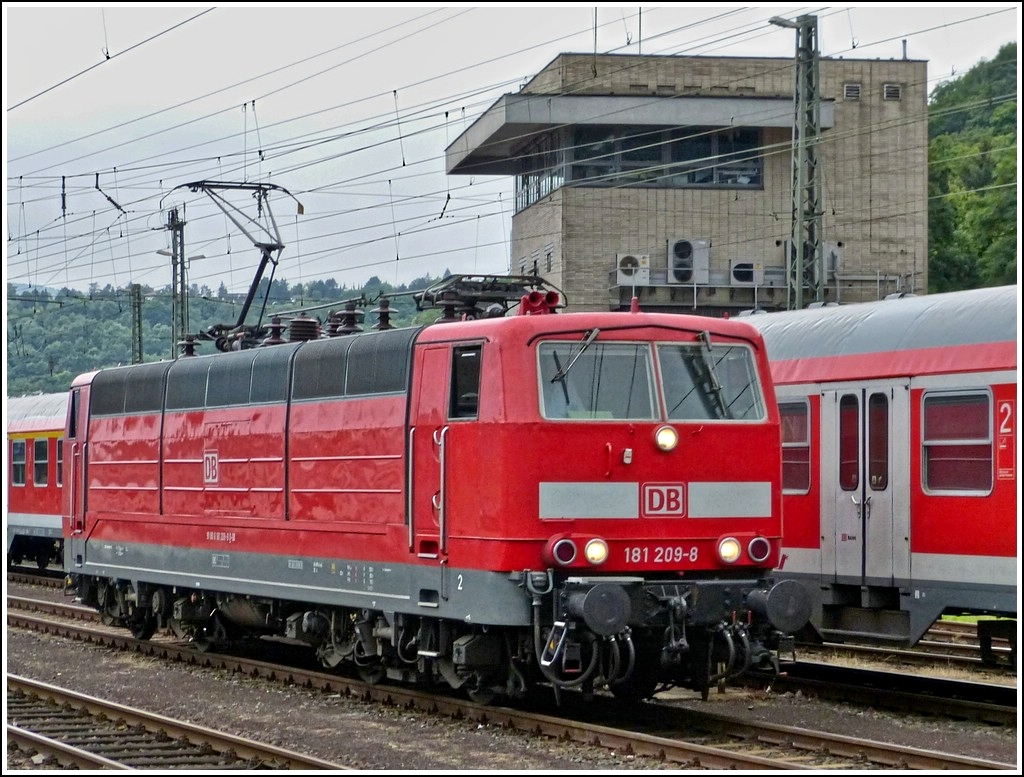 181 209-8 is runnning through the main station of Koblenz on July 28th, 2012.