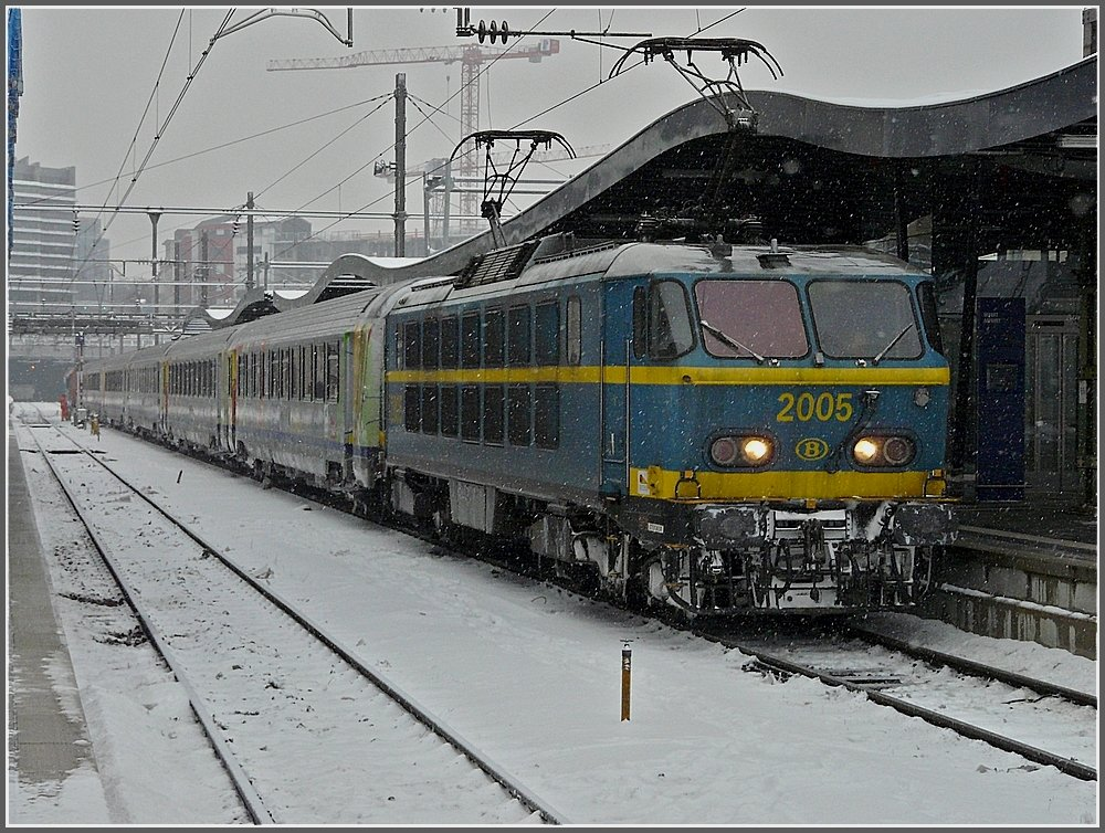 2005 with SNCF wagons is waiting for the departure to Brussels in the snowy station of Luxembourg City on December 21th, 2009.