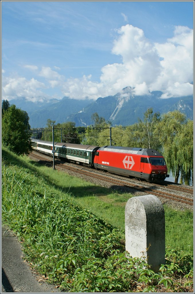 29 km to Lausanne, 25 km to St-Maurice  said the Stone on the Street. In the background Re 460 044-9 with IR to Genève Aéroport.