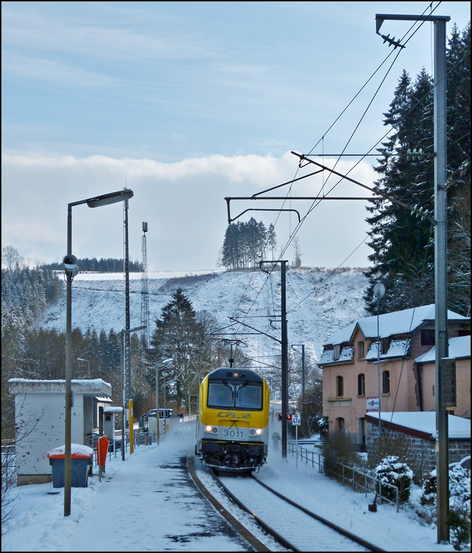 3011 is hauling the IR 112 Luxembourg City - Liers through the stop Maulusmühle on February 9th, 2013.