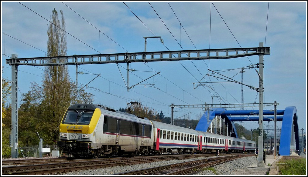 3012 is hauling the IR 113 Liers - Luxembourg City over the new Alzette bridge in Ettelbrück on October 24th, 2011.