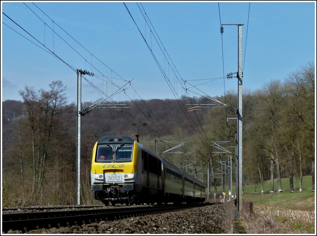 3012 is heading the IR 115 Liers - Luxembourg City near Colmar-Berg on March 9th, 2012.