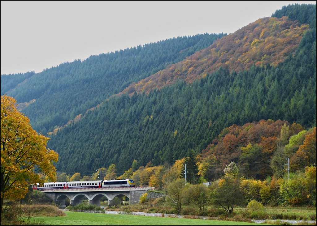 3017 is hauling the IR 112 Luxembourg City - Liers over the Sûre bridge near Michelau on October 22nd, 2012.