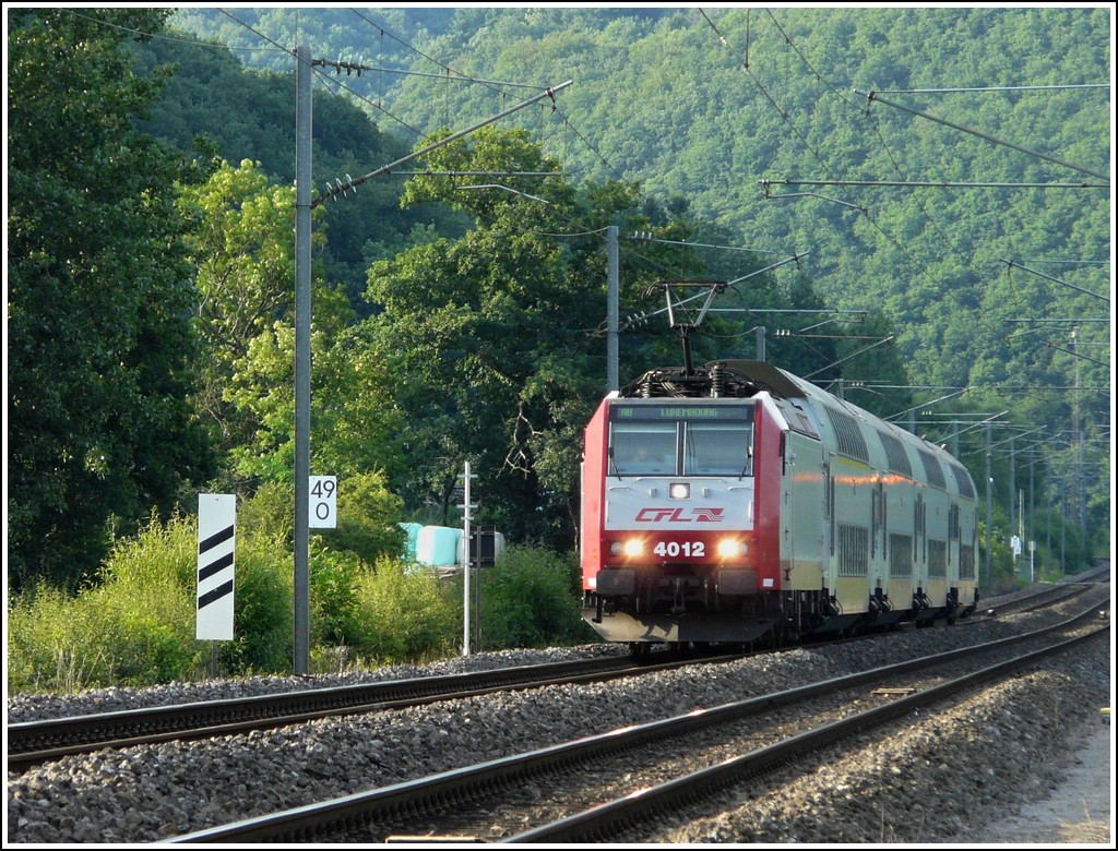 4012 is hauling the RB 3244 Wiltz - Luxembourg City through Erpeldange/Ettelbrück on July 10th, 2008.