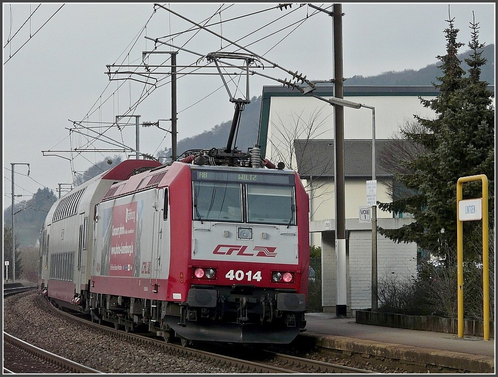 4014 is pushing its train out of the station of Lintgen on February 18th, 2010.