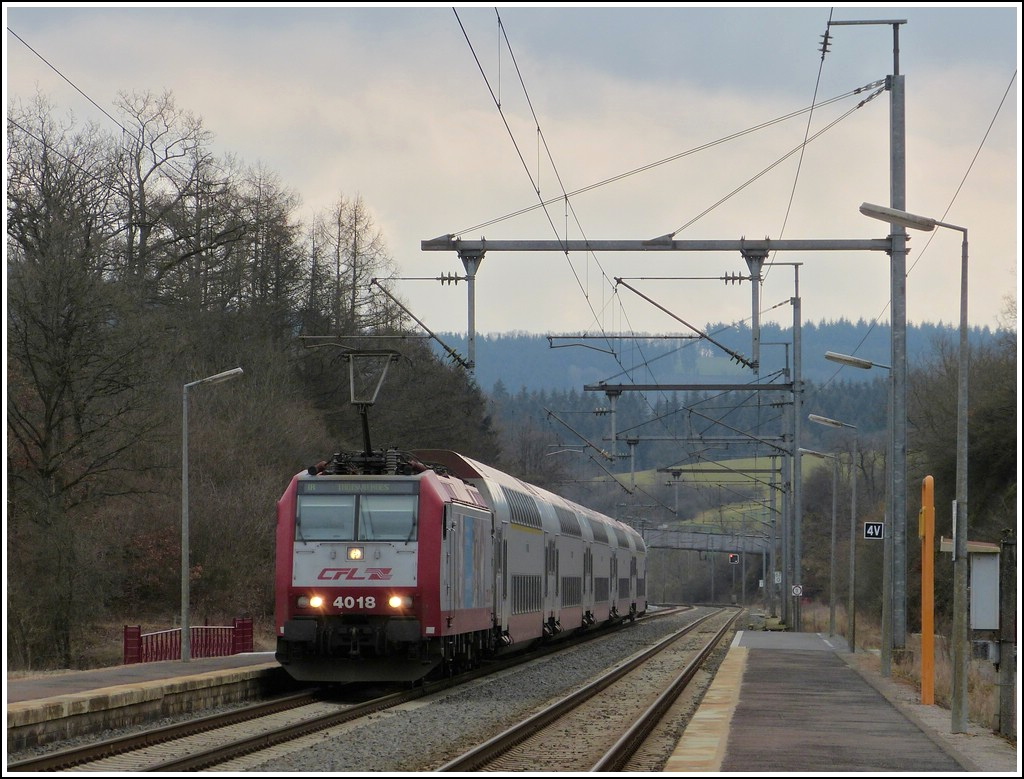 4018 is heading the IR 3710 Luxembourg City - Troisvierges in Wilwerwiltz on March 19th, 2012.