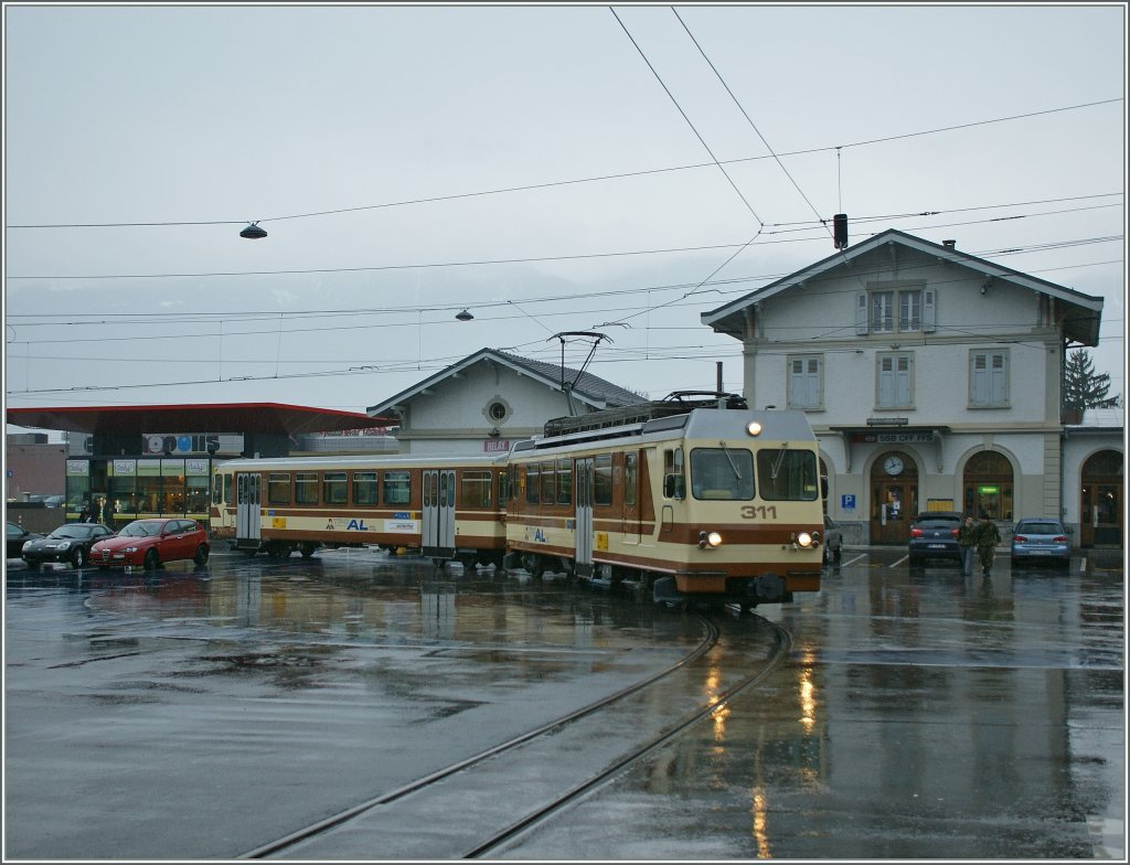A A-L local train is leaving Aigle Station. 