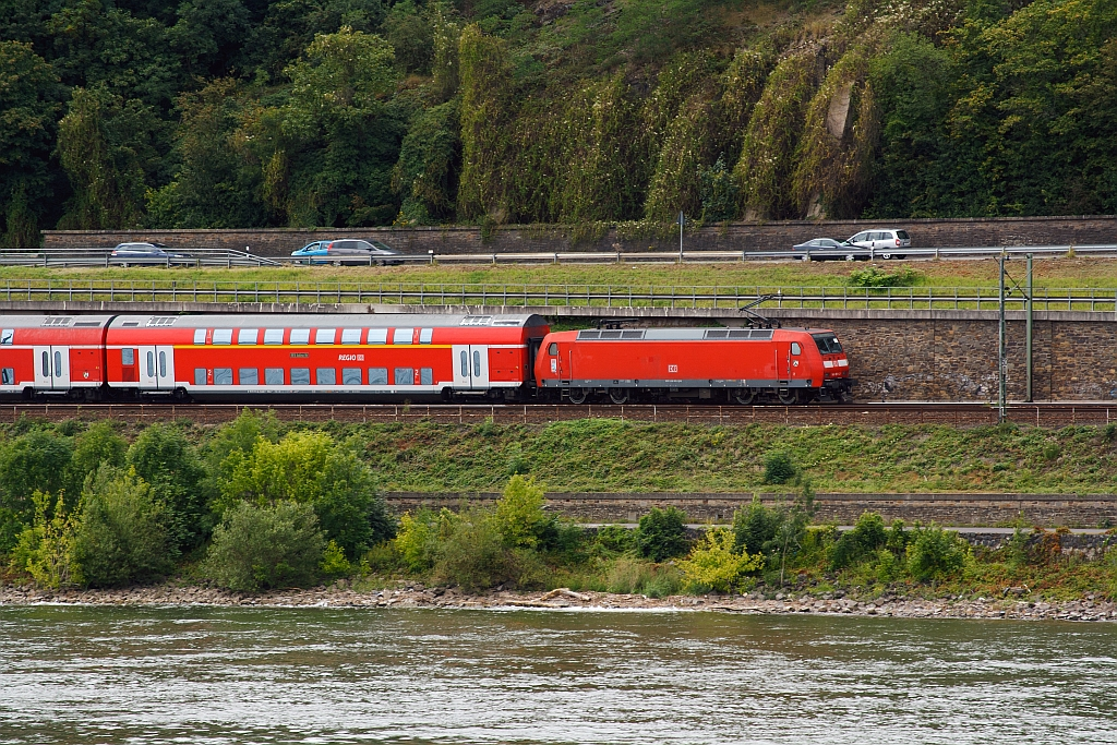 A German Class 146 with the RE 5 - Rhein-Express (Emmerrich -Cologne-Koblenz), on 11.08.2011,  runs at the left side of the Rhine upwards, across from Unkel, towards Koblenz Hbf.