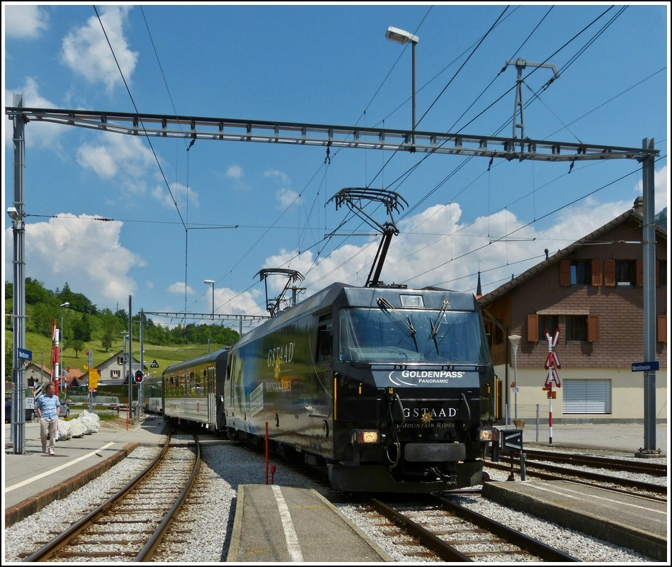A Goldenpass train is arriving in Montbovon on May 28th, 2012.