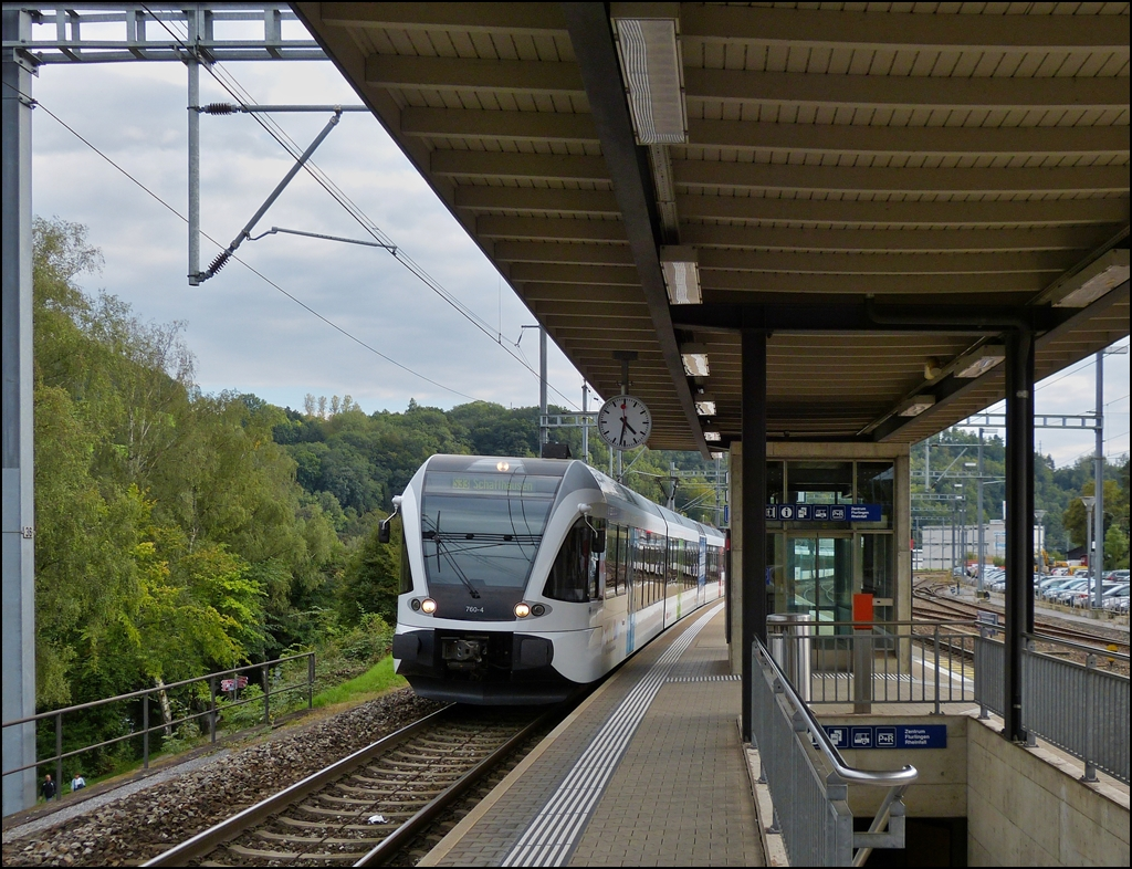 A local train to Schaffhausen is arriving in Neuhausen am Rheinfall on September 13th, 2012.