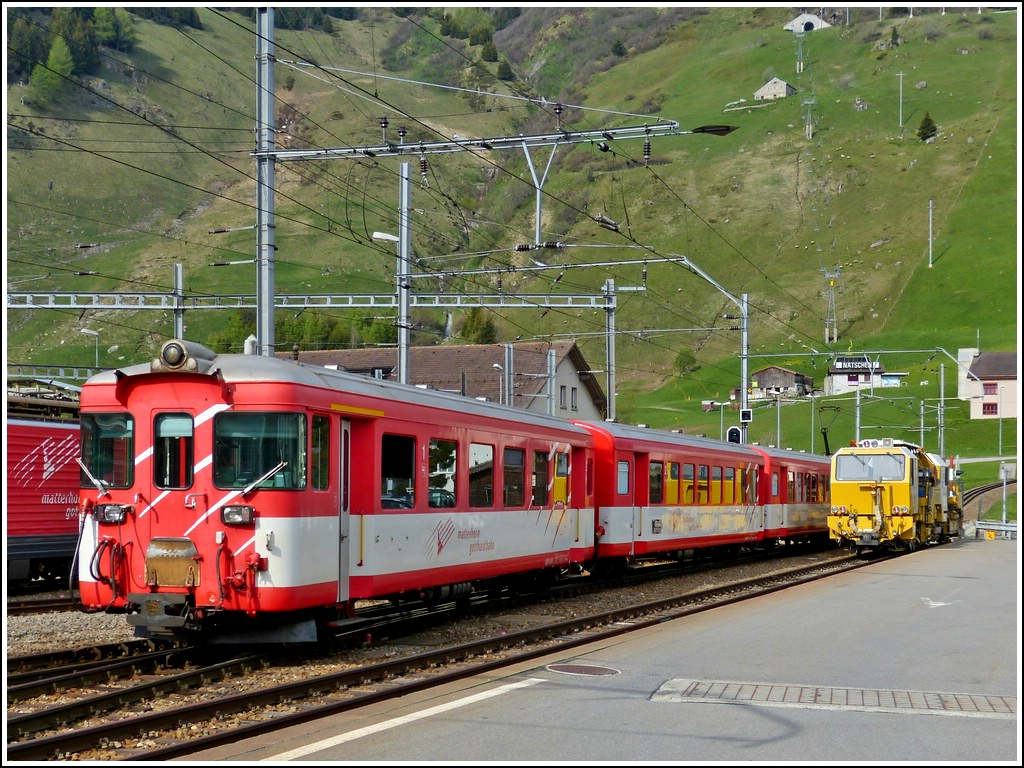 A MGB local train to Brig is leaving the station of Andermatt on May 24th, 2012.