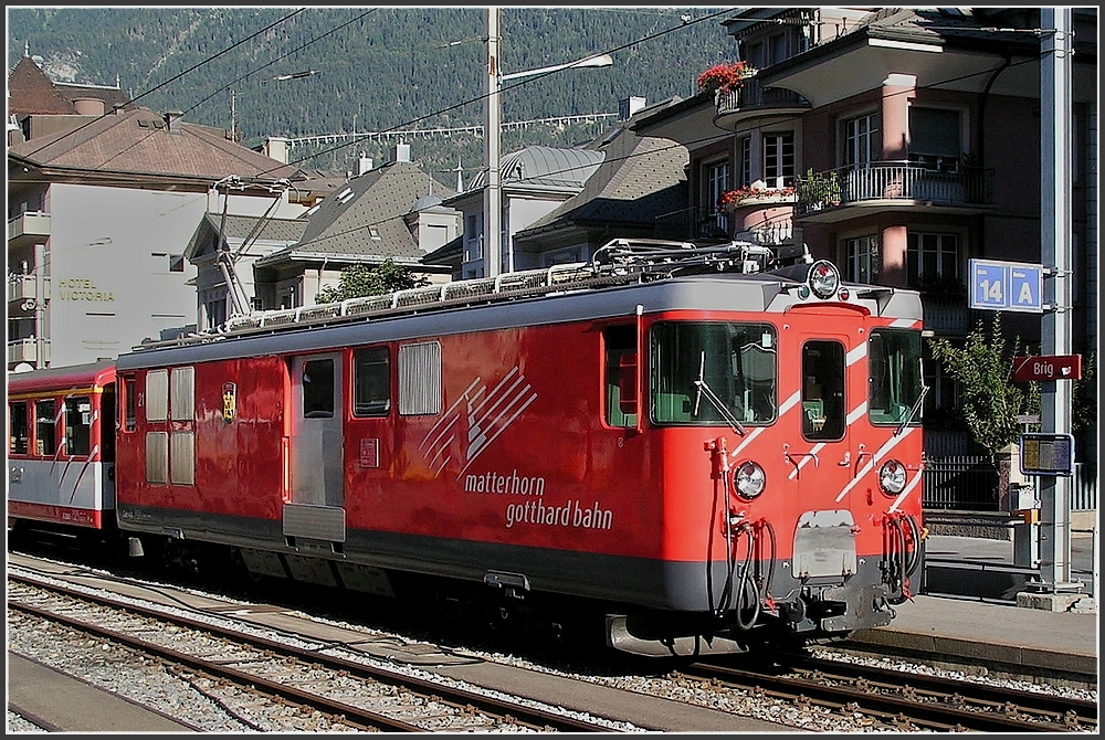 A MGB local train to Zermatt is leaving the station of Brig on July 30th, 2007.