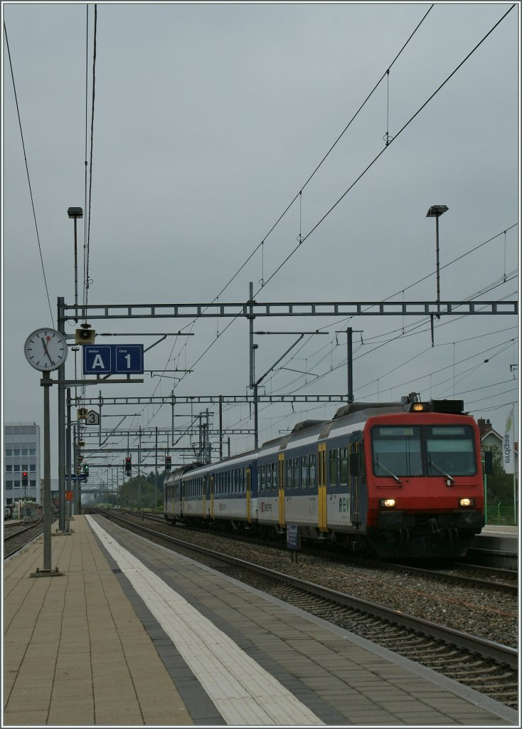 A NPZ is arriving at The Grenchen Süd Station. 