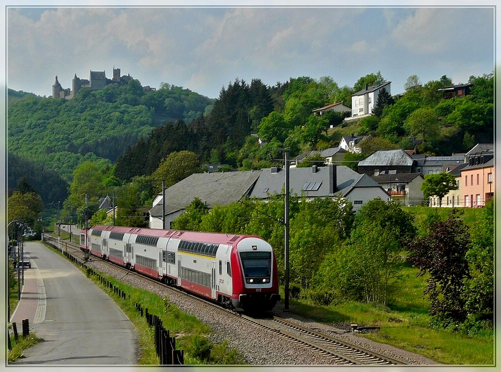 A push-pull train as local train 3241 Wiltz - Luxembourg City is running through the Sûre valley in Michelau on May 1st, 2011.