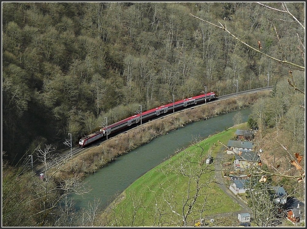 A push-pull train is running along the river Sûre near Bourscheid on March 29th, 2009.