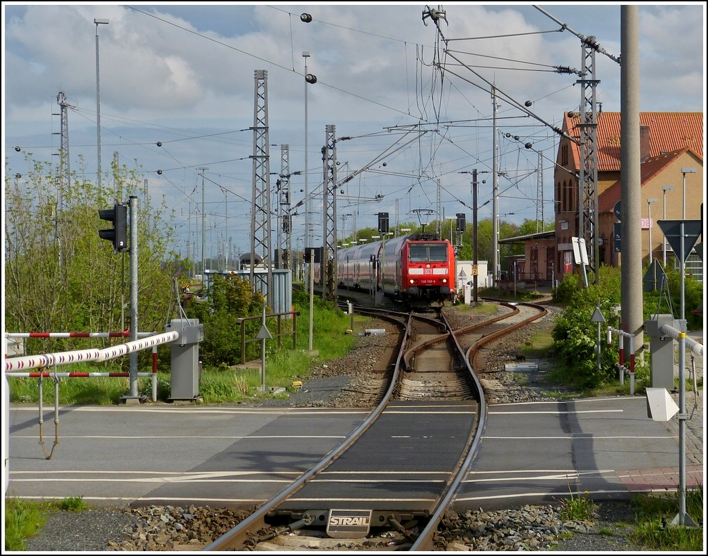 A RE to Norddeich Mole is leaving the station of Norddeich on May 11th, 2012.