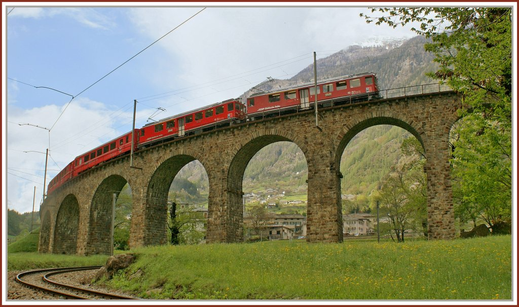A RhB local train to St. Moritz on the famous Brusio Circle -Viaduct. 