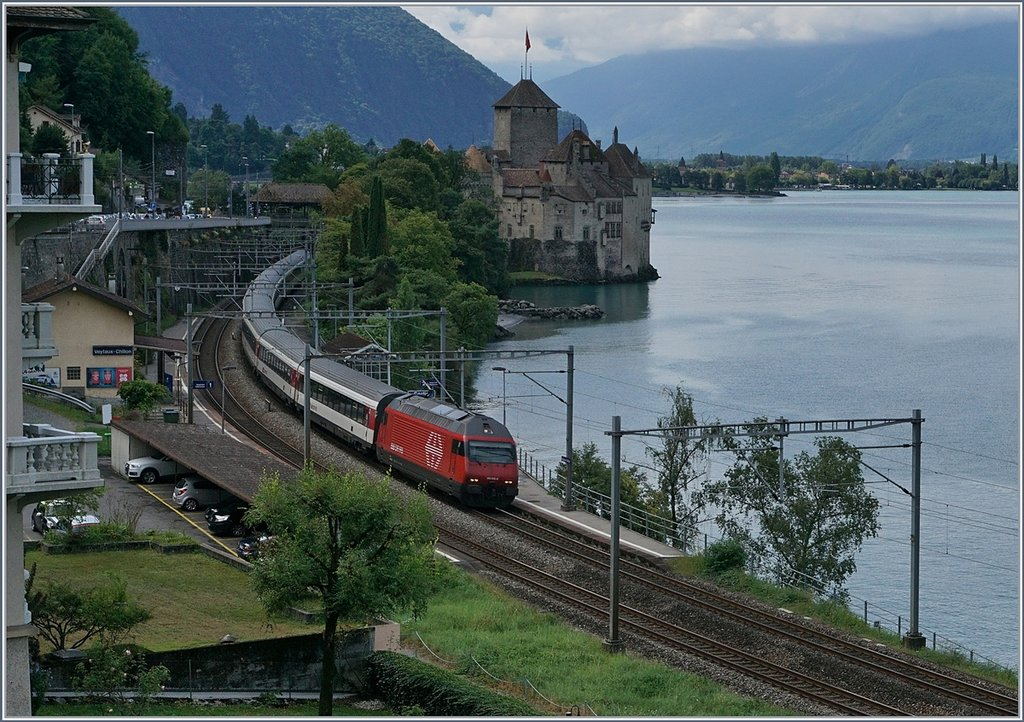 A SBB Re460 with an IR by the Castle of Chillon.