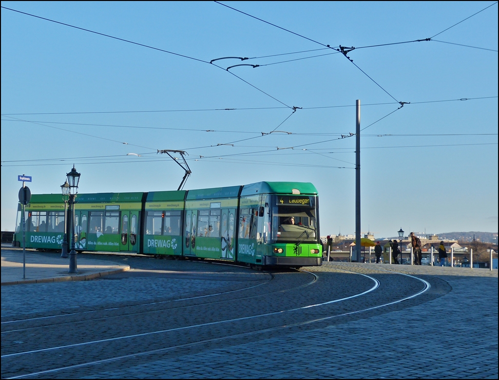 A tram is leaving the Augustusbrücke in Dresden and is entering into Sophienstraße on December 28th, 2012.