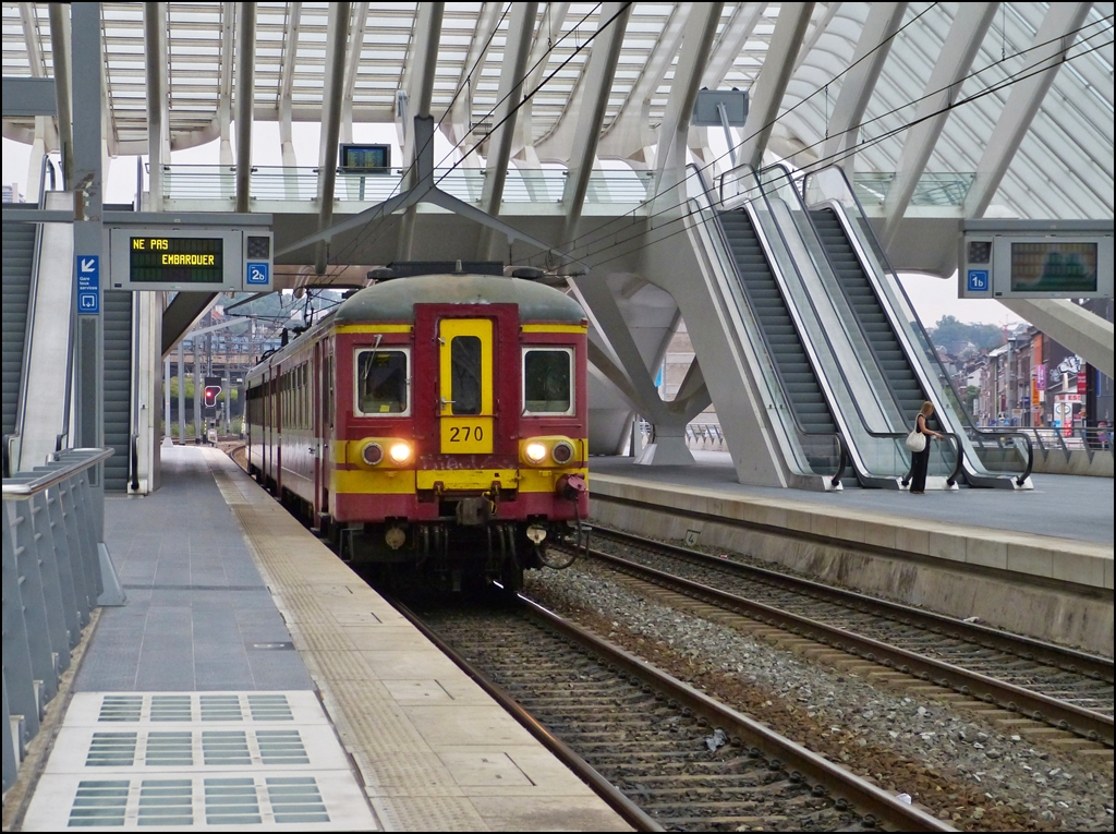 AM 65 270 is entering into the station Liége Guillemins on August 22nd, 2012.