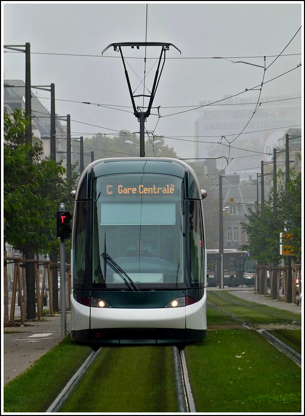 An Eurotram is running through the Boulevard du Président Wilson just before arriving at the stop Gare Centrale in Strasbourg on October 31st, 2011.