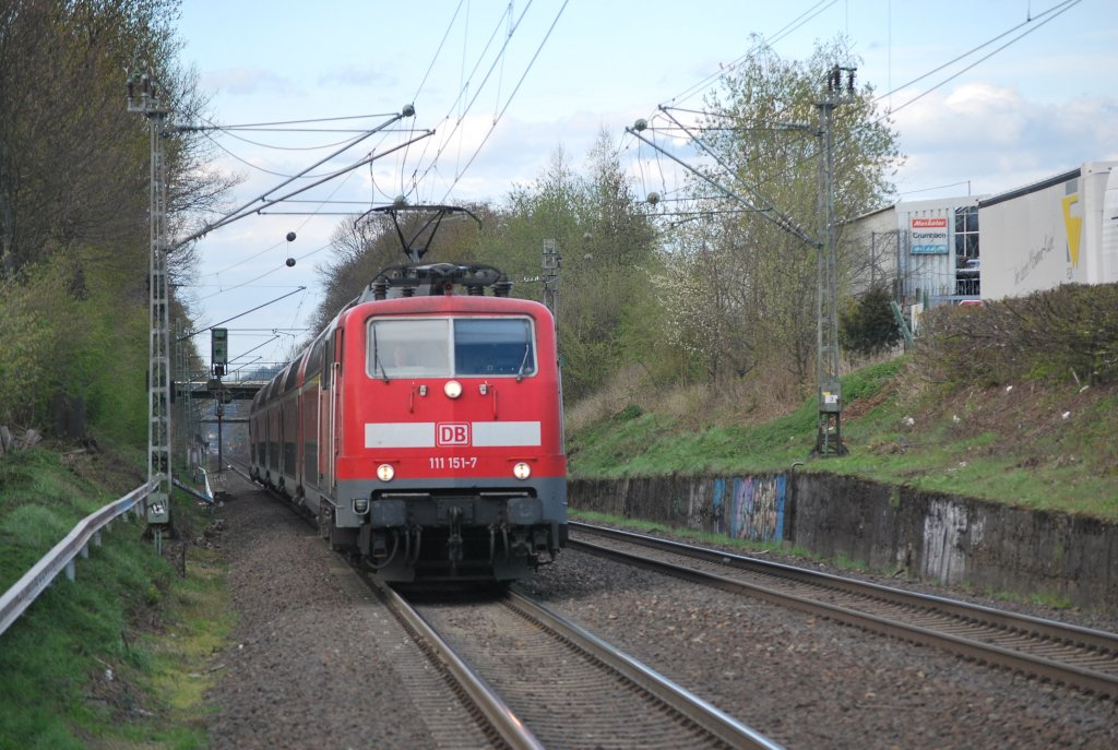 Electric engine 111 151-7 hauling Regionalexpress 4 Dortmund-Aachen past Kohlscheid (18th April 2012).