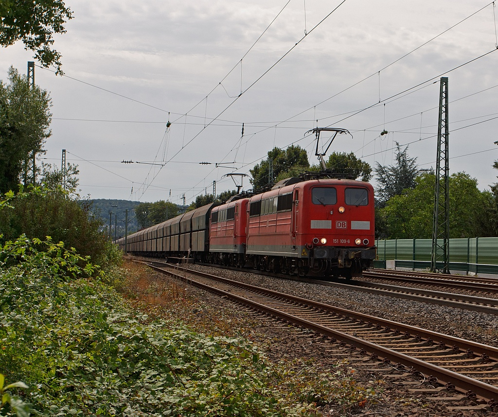 Electric locomotives 151109-6 and 151036-6, pull a Xpedys ore train, on 11.08.2011, on the right Rhein route, at Unkel to north.