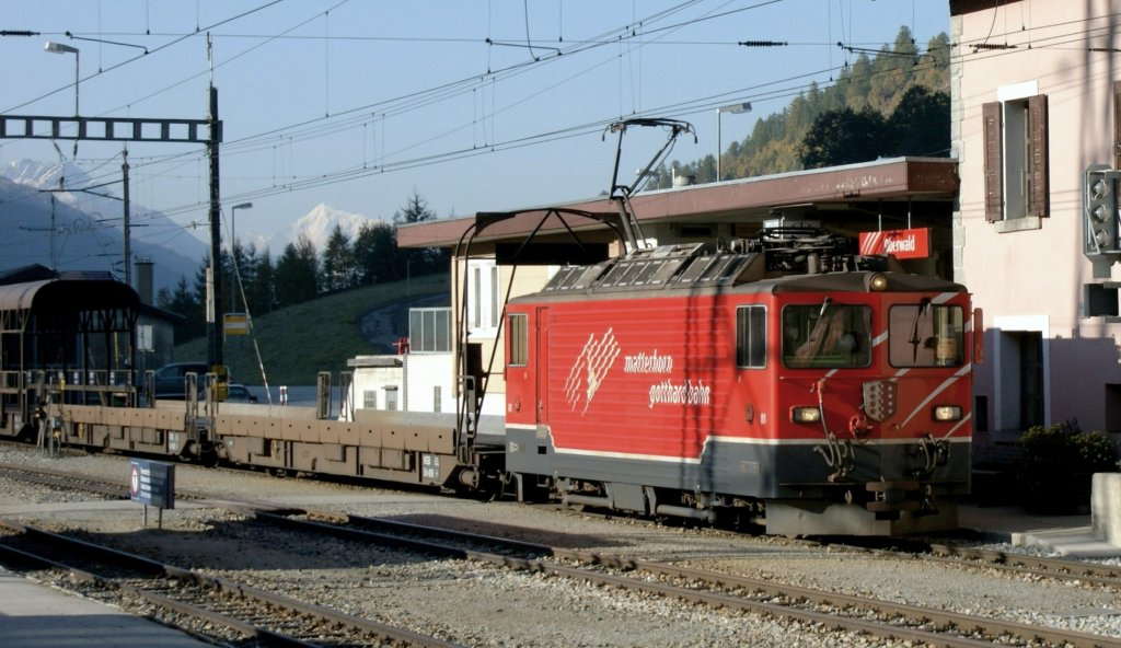 Ge 4/4 with a tunnel Auto-transport-shuttle in Oberwald.