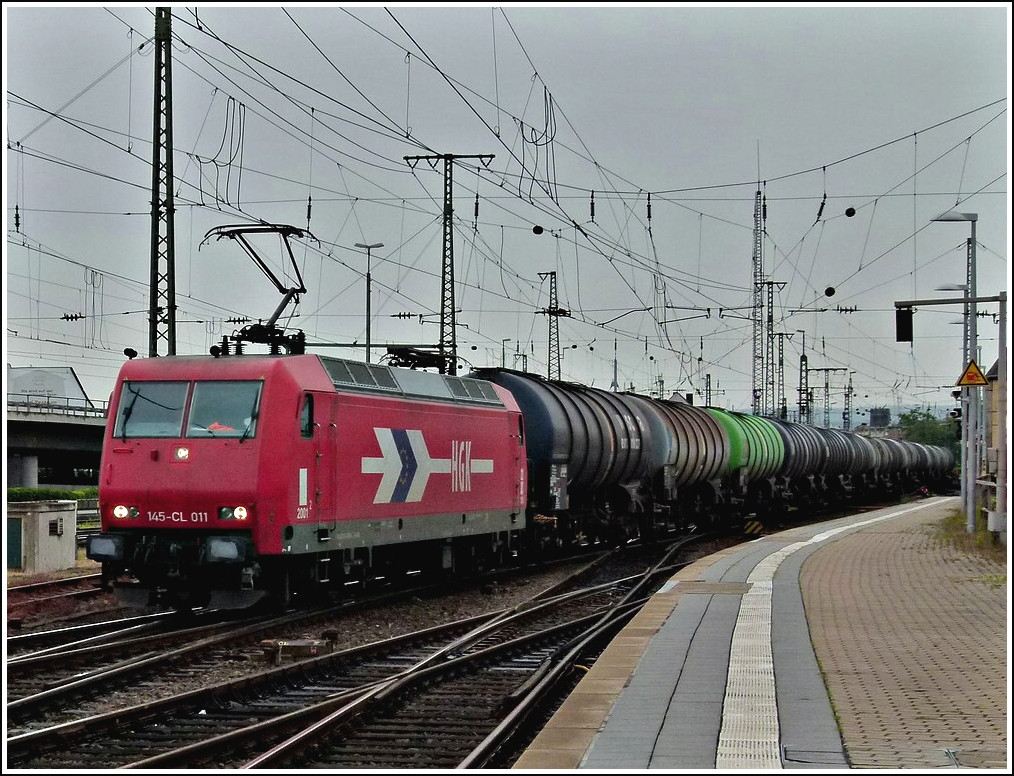 HGK 145-CL 011 is heading a freight train in Koblenz on June 25th, 2011.