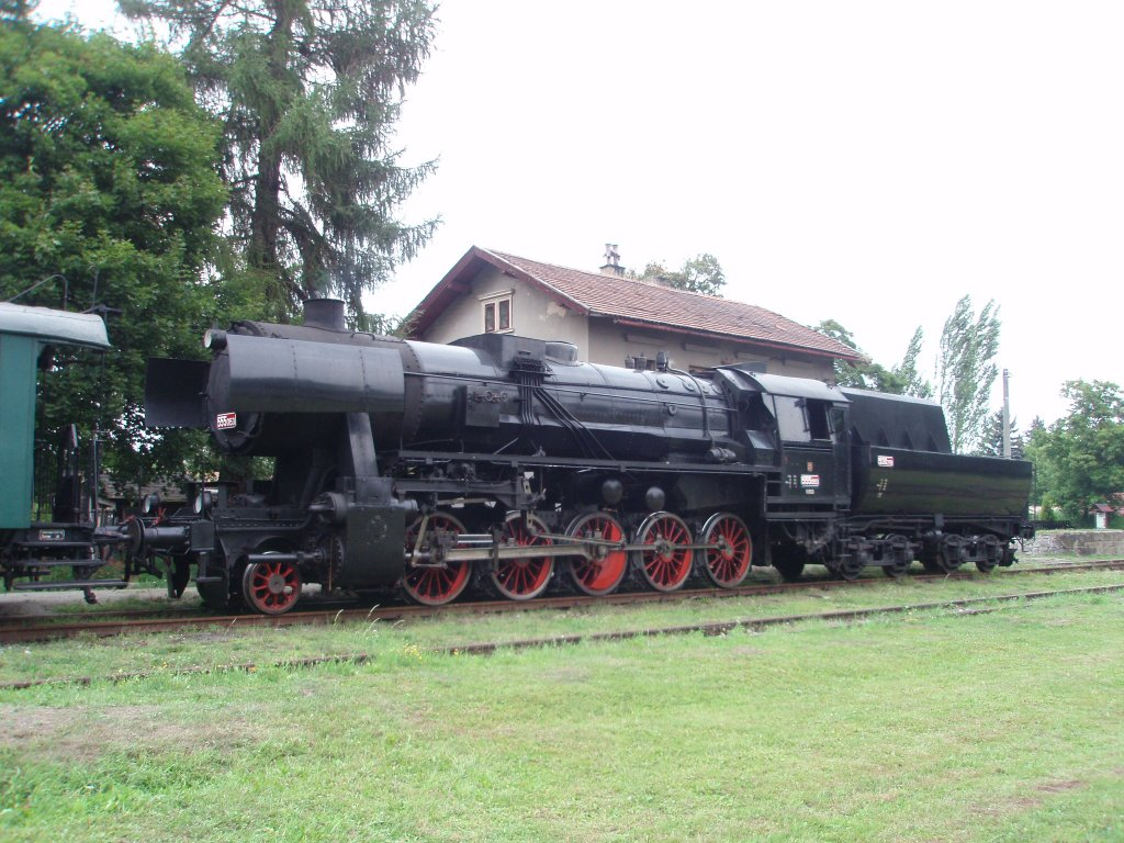 Historical steam locomotive 555.0153(BR 52)28.7.2012 at the railway station Kně¸eves. A special train  Kole¨ovka . Every Saturday in the Summer from station Lu¸ná to station Kole¨ovice an back. http://www.khkd.cz/in_e.htm