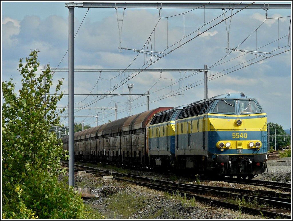 HLD 55 double header is hauling a goods train through the station of Montzen on July 12th, 2008.