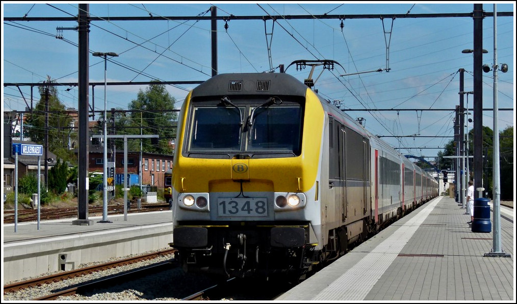 HLE 1348 is heading the IC A Eupen - Oostende in Welkenraedt on August 20th, 2011.