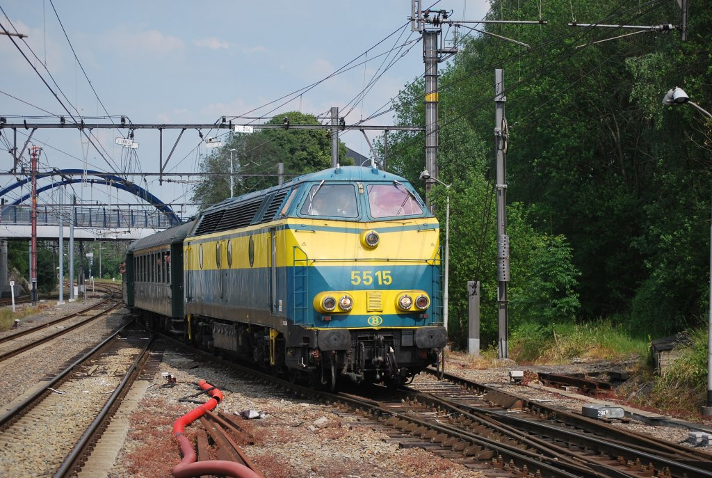 On a last day trip, two HLD 55s are hauling/pushing a special train through Welkenraedt station (June 2011).