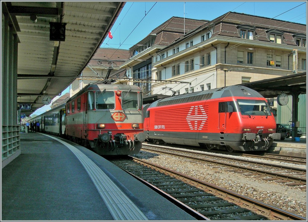 Re 4/4 II 11109 and Re 460 015-6 im Lausanne. 