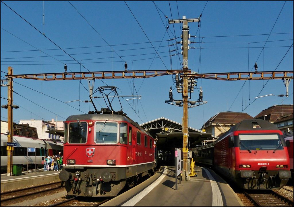Re 4/4 II 11128 and Re 460 089-6 pictured in Lausanne on May 29th, 2012.