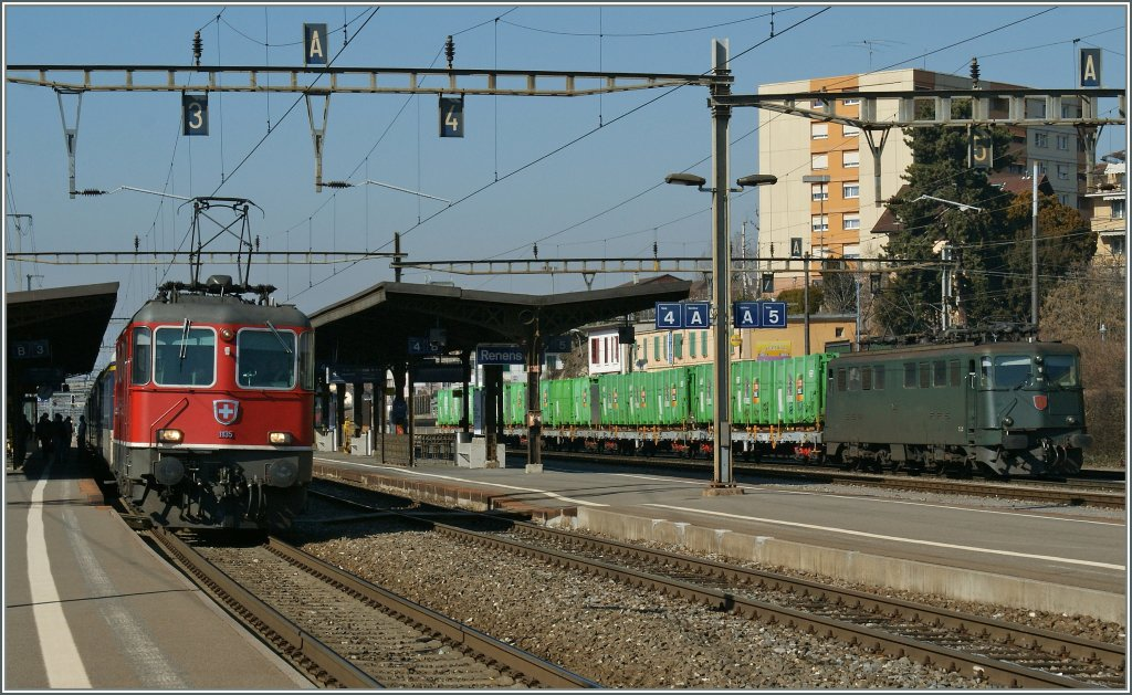 Re 4/4 II 11135 with a RE to Lausanne. In the backgroud an Ae 6/6.