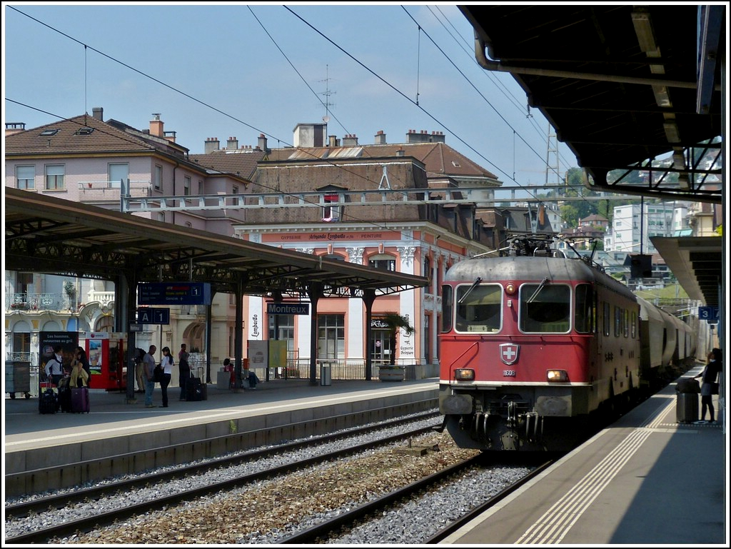 Re 4/4 II 11608 is hauling a goods train through the station of Montreux on May 25th, 2012.