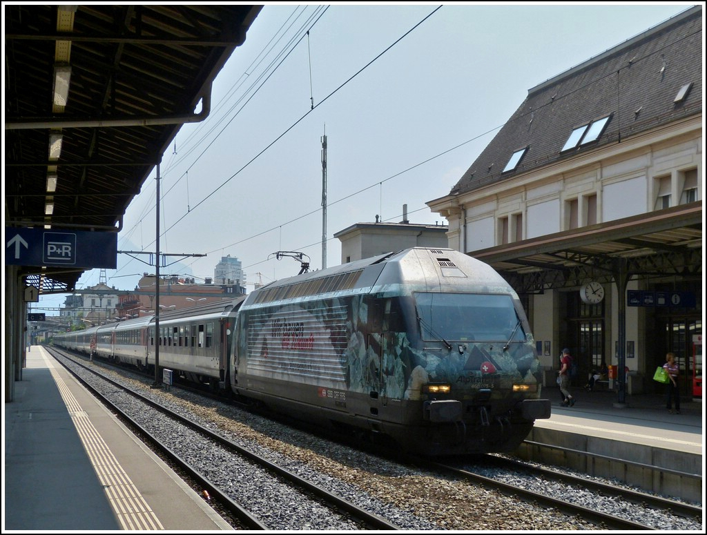 Re 460 075-5 is hauling a IR Brig - Geneva into the station of Montreux on May 25th, 2012.
