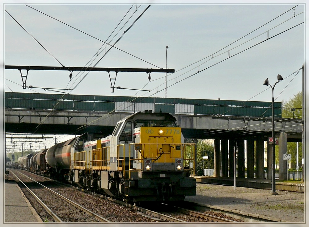 Série 77 double header is hauling a goods train through the station Antwerpen Noorderdokken on April 24th, 2010.