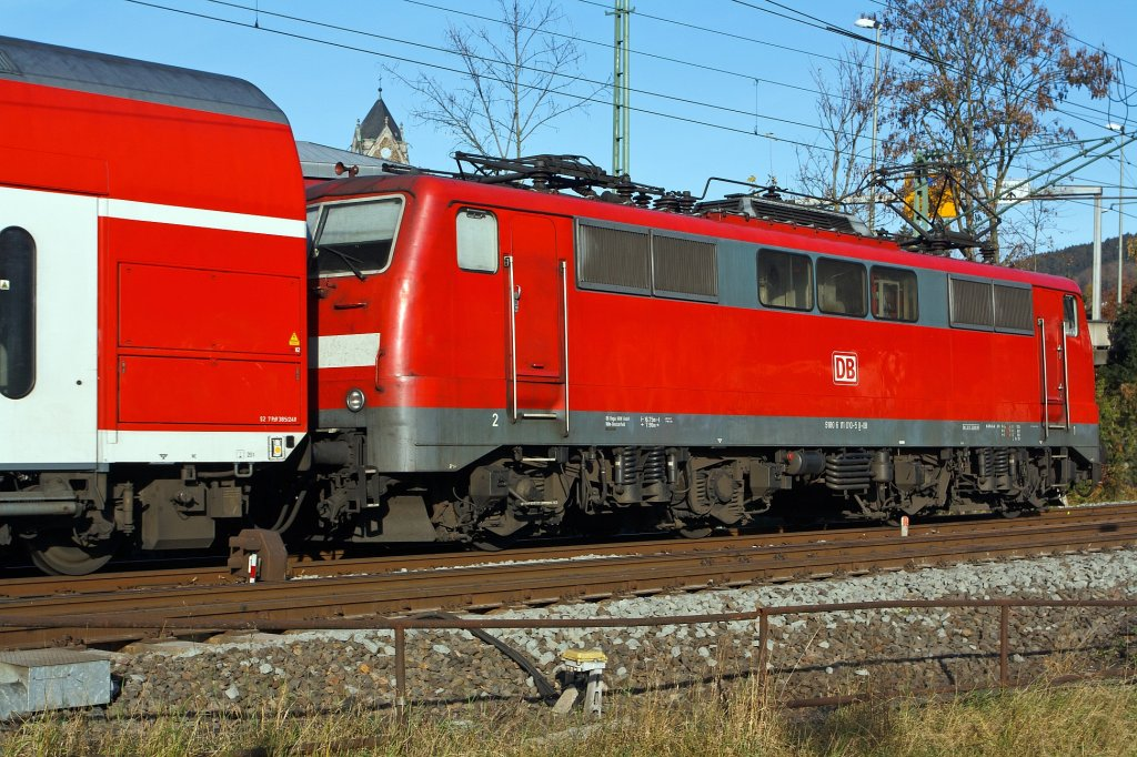 The 111010-5 pushes the RE 9 - Rhein-Sieg-Express (Siegen main station - Aachen main station), here briefly before entering the station Betzdorf / Sieg on 13.11.2011.